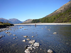 Hurunui River - A mountainbiker crossing the Hurunui River upstream of Lake Sumner