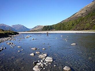 Hurunui River - A mountainbiker crossing the Hurunui River upstream of Lake Sumner