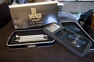 "DJ Hero - The ""Renegade"" edition of DJ Hero includes the turntable controller and a case that can be converted into a stand for the controller."