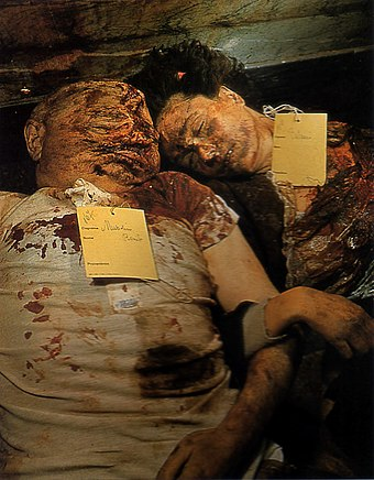 The bodies of Mussolini and Petacci photographed by a US army cameraman in the Milan city morgue. DeadMussolini.jpg
