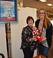 Debbie Macomber with Jacob and Annmarie Wilson 161203-N-SP496-004.jpg