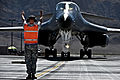 Defense.gov News Photo 110920-F-KX404-055 - U.S. Air Force Senior Airman Jonathon Hartman directs the flight crew of a B-1B Lancer aircraft during Green Flag-West 11-10 at Nellis Air Force.jpg