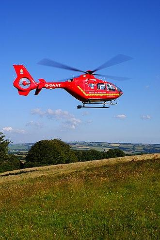 Devon Air Ambulance - Devon Air Ambulance helicopter G-DAAT, near Dunkery Beacon on Exmoor