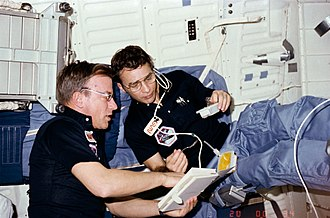 Paul J. Weitz - Weitz and Donald H. Peterson (right) aboard space shuttle Challenger during the STS-6 mission