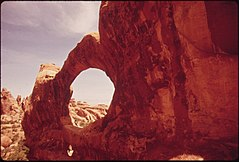 Double O Arch, One of Many Windows Carved Into Vertical Redrock by Centuries of Erosion, 05-1972 (3814151075).jpg