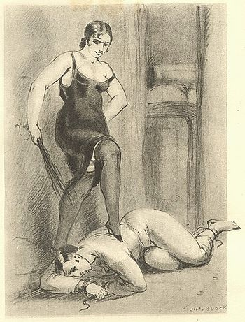 English: Woman standing on submissive male.