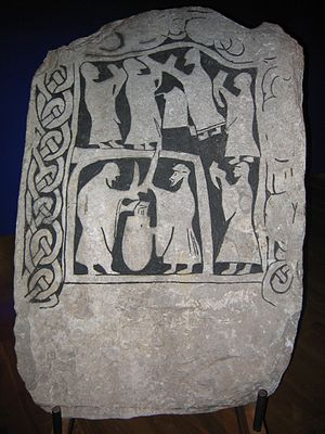 Norse funeral - A drinking scene on an image stone from Gotland, Sweden, in the Swedish Museum of National Antiquities in Stockholm.