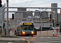 Dual-mode bus in electric mode at top of Silver Line Waterfront tunnel ramp in Boston (2007).jpg