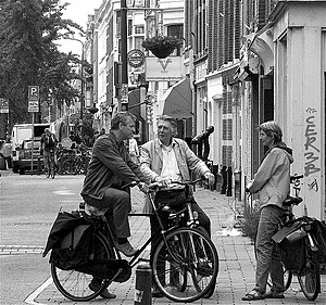 Dutch people talking on the streets.