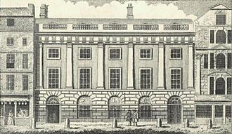 Sidewalk - East India House, Leadenhall Street, London, 1766. The pavement is separated from the main street by six bollards in front of the building.