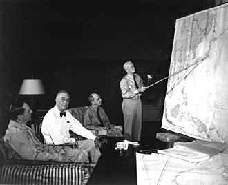 Asiatic-Pacific Theater - 1944 Strategy Conference in Honolulu. Left to right: MacArthur, Roosevelt, Leahy, Nimitz.  The discussion weighs the options of Formosa or the Philippine Islands as the next operational target in the Pacific theater.