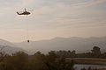 FEMA - 33366 - Helicopters scoop water from a pond to stop the Poomacha fire in California.jpg