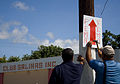 FEMA - 39285 - Workers put up signs to the FEMA DRC in Puerto Rico.jpg