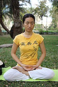 Falun Dafa fifth meditation exercise by HappyInGeneral on Wikimedia commons