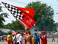 Ferrari and Renault fans with flag 2006 Indianapolis.jpg