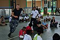 Flickr - Official U.S. Navy Imagery - A Sailor plays with children..jpg