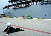 Flickr - Official U.S. Navy Imagery - A boy in a Sailor's outfit watches as Sailors man the rails..jpg