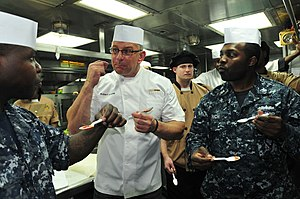 Robert Irvine - Irvine giving culinary advice to cooks aboard a US Navy ship in October 2012.