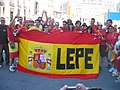 Football fans with defaced flag of Spain.jpg