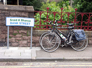 Bilingual signage in Fort William with bicycles