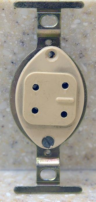 Telephone plug - Image: Four prong telephone jack, 1960s, front