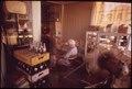 GROCERY STORE PROPRIETOR DOZES ON A QUIET AFTERNOON - NARA - 547805.tif