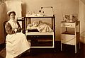 General Lying In Hospital, York Road; nurse sitting with bab Wellcome V0029090.jpg