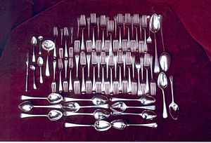 Cutlery - A set (known as a canteen) of Georgian era silver cutlery, including ladles, and serving spoons. The thin item on the left is a marrow scoop for eating Bone marrow