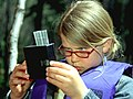Girl examining specimen during Wolftree Outing-Deschutes (25827740724).jpg