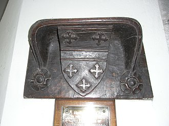 Clearwell - Bracket seat c. 1480, Mitcheldean Church, formerly attached to ancient pulpit, showing arms of Greyndour: Or, a fess between 5 crosses crosslet gules 2 and 3, as depicted on the 19th-century monument to Thomas Baynham (d. 1500) in the same church