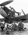 Ground staff work on a No. 610 Squadron Spitfire Mk V at Westhampnett, 11 April 1943. CH9248.jpg