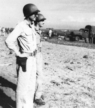 Battle of Mount Austen, the Galloping Horse, and the Sea Horse - U.S. Army Major General Alexander Patch (foreground) observes the landing of troops and supplies on Guadalcanal on 8 December.
