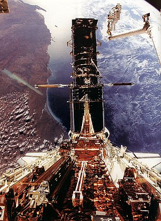 1993 in spaceflight - Astronauts Story Musgrave and Jeffrey Hoffman repair the Hubble Space Telescope during STS-61.