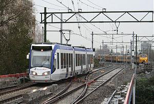 Den Haag Laan van NOI railway station - A RandstadRail and an NS Train at Laan van NOI