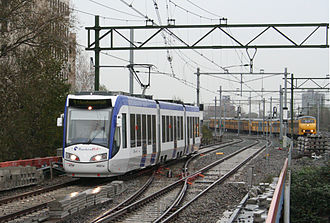 Den Haag Laan van NOI railway station - A RandstadRail and an NS Train at Laan van NOI