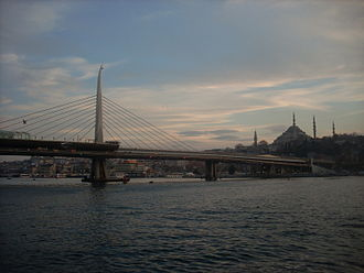 Golden Horn Metro Bridge - The bridge connects the Beyoğlu and Fatih districts on the northern and southern shores of the Golden Horn. Süleymaniye Mosque and Beyazıt Tower are seen in the background.