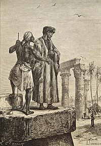 Engraving of Ibn Battuta standing with another man on a rock in Egypt.