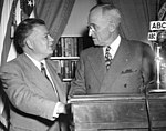 Harry Truman and David Dubinsky at a podium with an ABC microphone.jpg