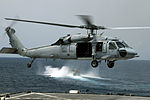 Helicopter lifts off USS Harpers Ferry DVIDS93487.jpg