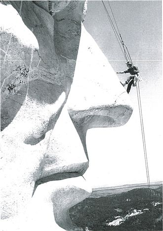 Jan and Herb Conn - Herb Conn doing maintenance work on Mount Rushmore in 1960s or 1970s