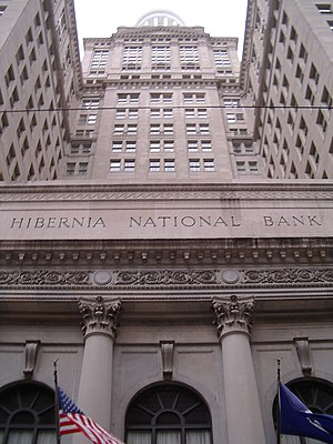 """Hibernia National Bank - The Hibernia Bank Building, former headquarters in the CBD of New Orleans.  Though all former Hibernia branches have been rebranded as """"Capital One Bank,"""" this building's historic name and signage remain unaltered."""