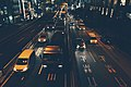 Highway intersection at night-time (Unsplash).jpg