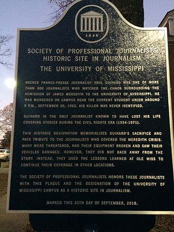A plaque outside the Meek School of Journalism and New Media declaring campus a historic landmark in journalism by the Society of Professional Journalists Historical Landmark Plague.jpg
