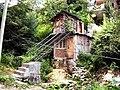 House with bridge for monsoon floods. Manali.jpg