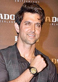A photograph of Hrithik Roshan smiling away from the camera.