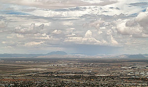Hueco Mountains - Hueco Mountains in sun and rain, with Cerro Alto prominent, as seen from the base of the tramway, El Paso, Texas, 30 miles west of Cerro Alto
