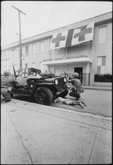 Humanitarian G.I.'s. Firefight where G.I. pushes little kid under jeep for protection, Santo Domingo, May 5., 1965 - NARA - 541806.tif