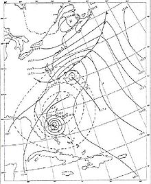 A weather chart on May 18 shows a developing tropical cyclone near the Bahamas.