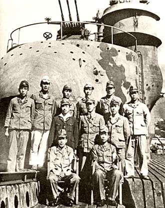 I-400-class submarine - Officers of I-400 in front of the plane hangar, photographed by the US Navy following the surrender of the submarine at sea, one week after the end of hostilities.