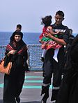 INS Mumbai crew provides succor to a child in distress while her mother looks on, during Operation Raahat.jpg